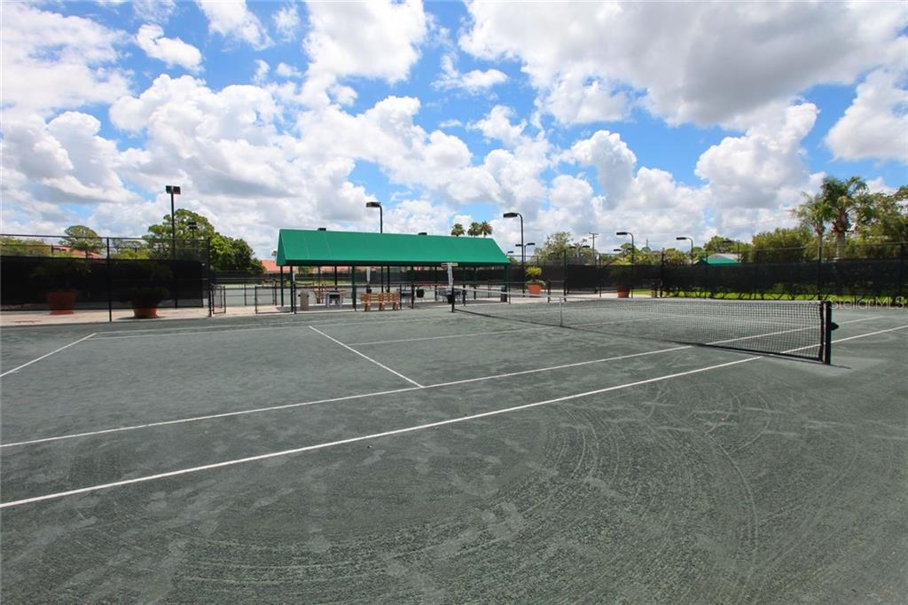 Tennis court - Single Family Home for sale at 5628 Country Lakes Dr E, Sarasota, FL 34243 - MLS Number is A4477442