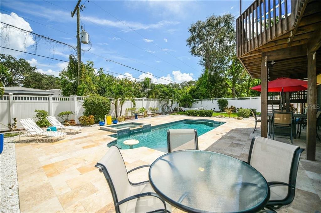 Pool/spa with travertine patio. - Single Family Home for sale at 7303 Westmoreland Dr, Sarasota, FL 34243 - MLS Number is A4478376