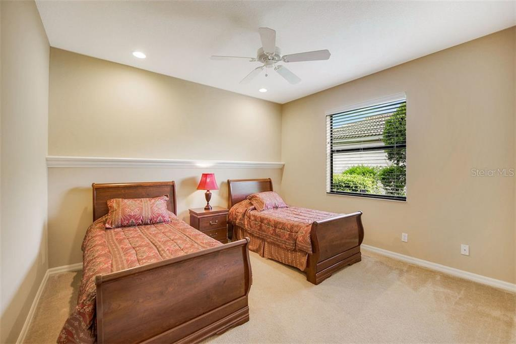 Bedroom 3 - Single Family Home for sale at 684 Crane Prairie Way, Osprey, FL 34229 - MLS Number is A4478575