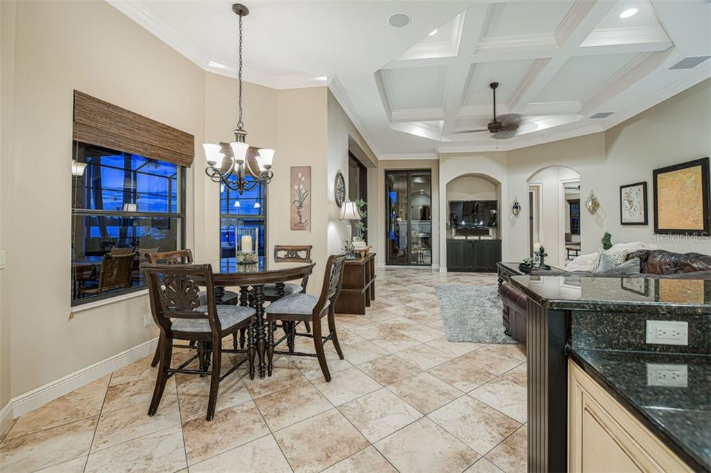 Dinette with windows overlooking the lake - Single Family Home for sale at 14507 Leopard Crk, Lakewood Ranch, FL 34202 - MLS Number is A4478709