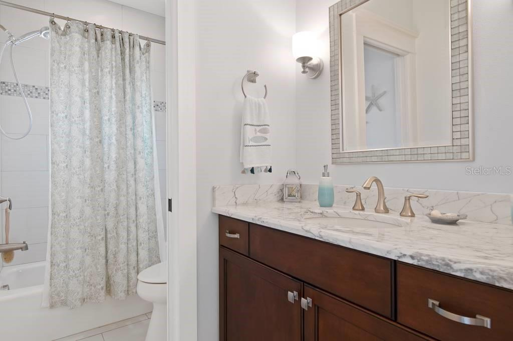 Third floor bathroom. - Single Family Home for sale at 718 Key Royale Dr, Holmes Beach, FL 34217 - MLS Number is A4480381
