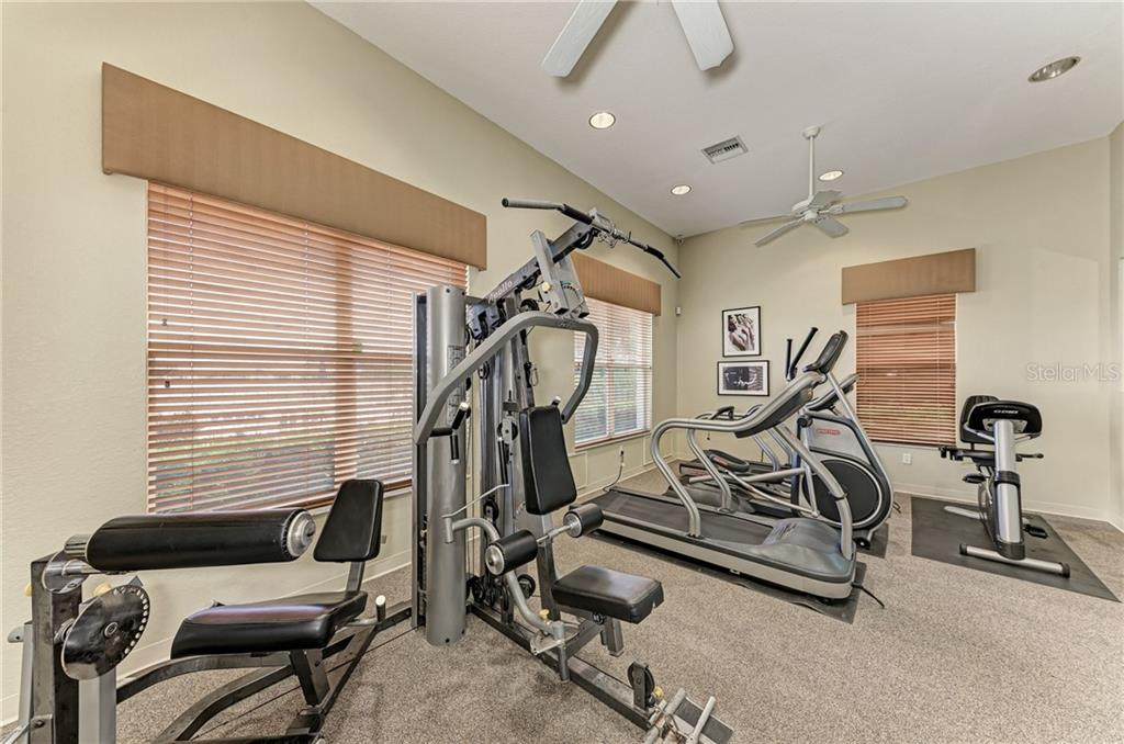 Community gym - Single Family Home for sale at 7118 68th Dr E, Bradenton, FL 34203 - MLS Number is A4480398