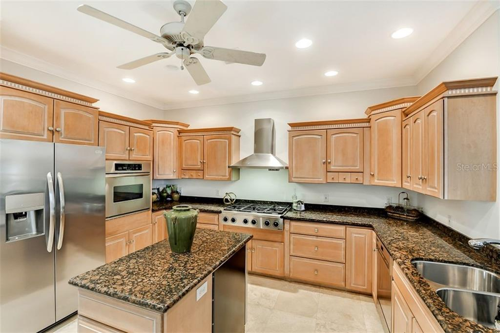 An open island with a wine frig for all your entertaining ! - Single Family Home for sale at 501 Cutter Ln, Longboat Key, FL 34228 - MLS Number is A4480484