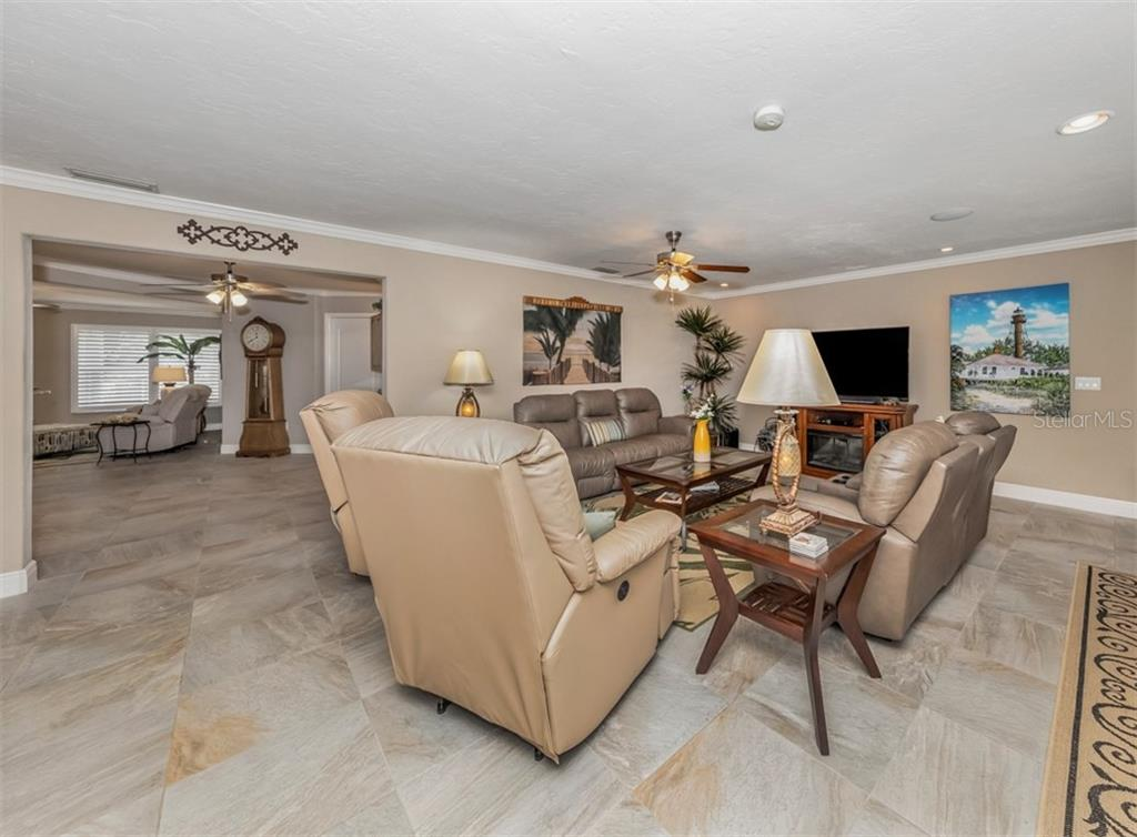 Family room, kitchen - Single Family Home for sale at 1395 Bayshore Dr, Englewood, FL 34223 - MLS Number is A4480508