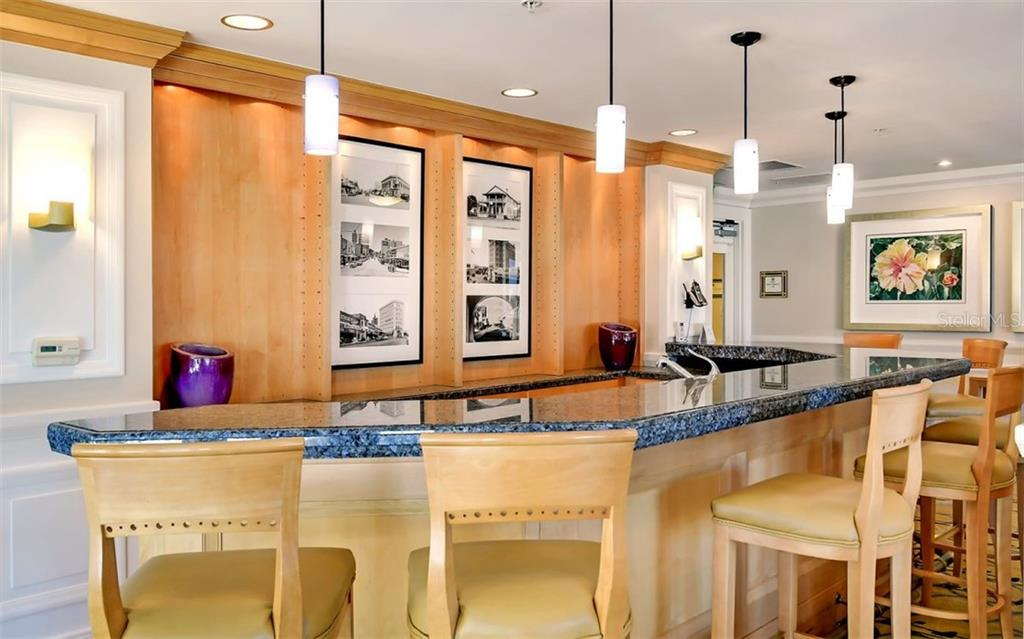 Bar in the club room with adjacent catering kitchen - Condo for sale at 50 Central Ave #16a, Sarasota, FL 34236 - MLS Number is A4482401