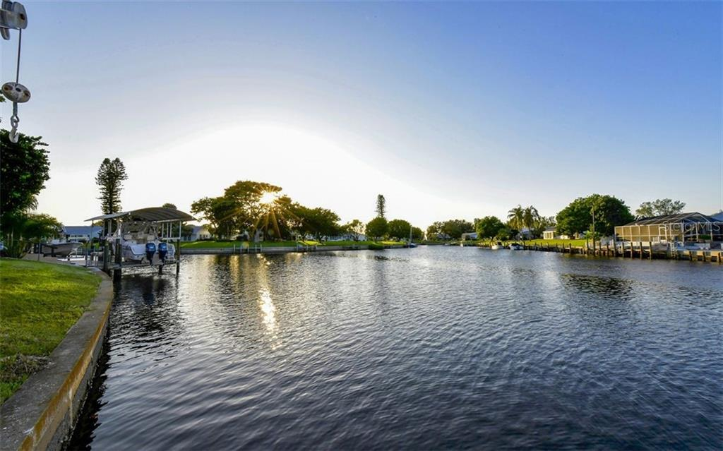 From easterly edge of property line-approximately 103 feet of waterfront - Single Family Home for sale at 9219 Bimini Dr, Bradenton, FL 34210 - MLS Number is A4483083