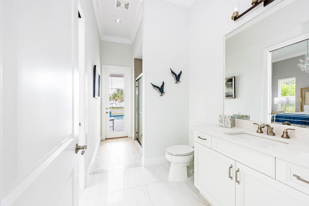 Pool Bathroom - Single Family Home for sale at 121 Seagull Ln, Sarasota, FL 34236 - MLS Number is A4483951