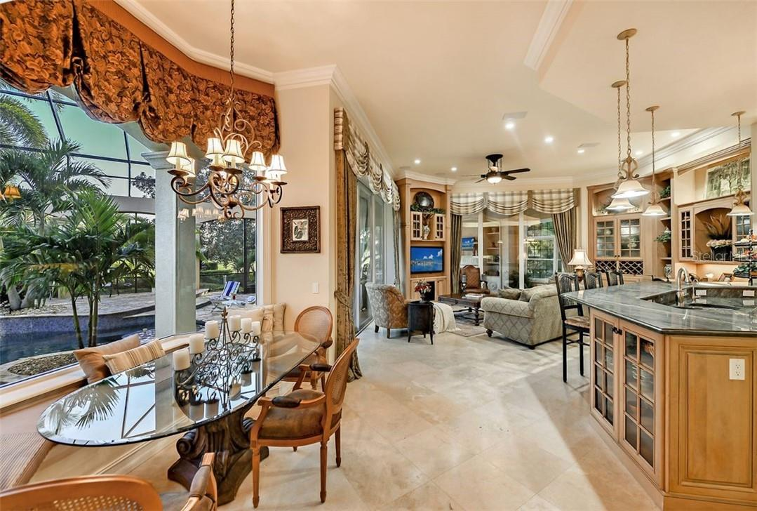 Beautiful custom banquette with seating for 8 or so...the breakfast bar is so close for overflow. - Single Family Home for sale at 8263 Archers Ct, Sarasota, FL 34240 - MLS Number is A4483993