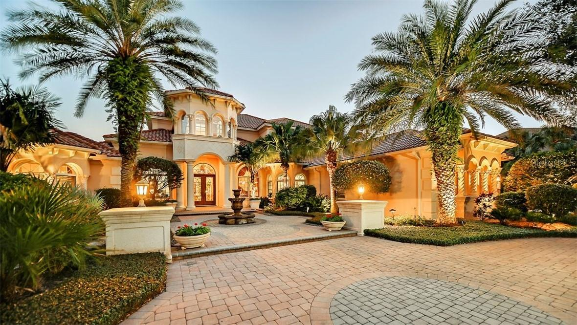This custom masonry estate sits on .75 acreage with a pond out front & a world class golf course in the backyard. - Single Family Home for sale at 8263 Archers Ct, Sarasota, FL 34240 - MLS Number is A4483993
