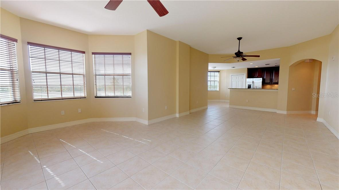 Open living, dining, kitchen - Condo for sale at 5591 Cannes Cir #506, Sarasota, FL 34231 - MLS Number is A4484243