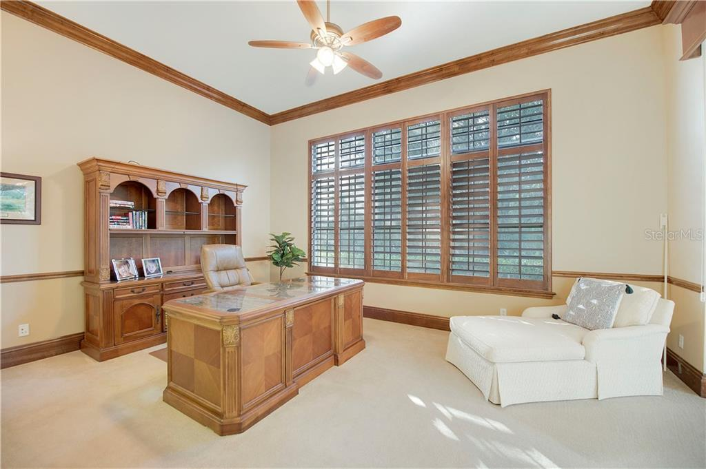 Oversized office/study with plantation shutters, sliders to the lanai, and wet bar - Single Family Home for sale at 13223 Palmers Creek Ter, Lakewood Ranch, FL 34202 - MLS Number is A4484826
