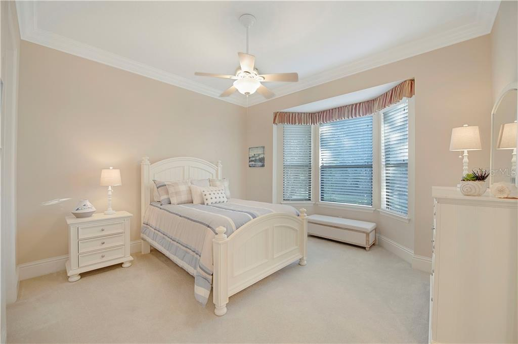 Bedroom 2 with large walk in closet and bay windows - Single Family Home for sale at 13223 Palmers Creek Ter, Lakewood Ranch, FL 34202 - MLS Number is A4484826