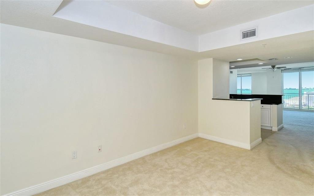 From the den looking toward the foyer - Condo for sale at 800 N Tamiami Trl #1007, Sarasota, FL 34236 - MLS Number is A4485565
