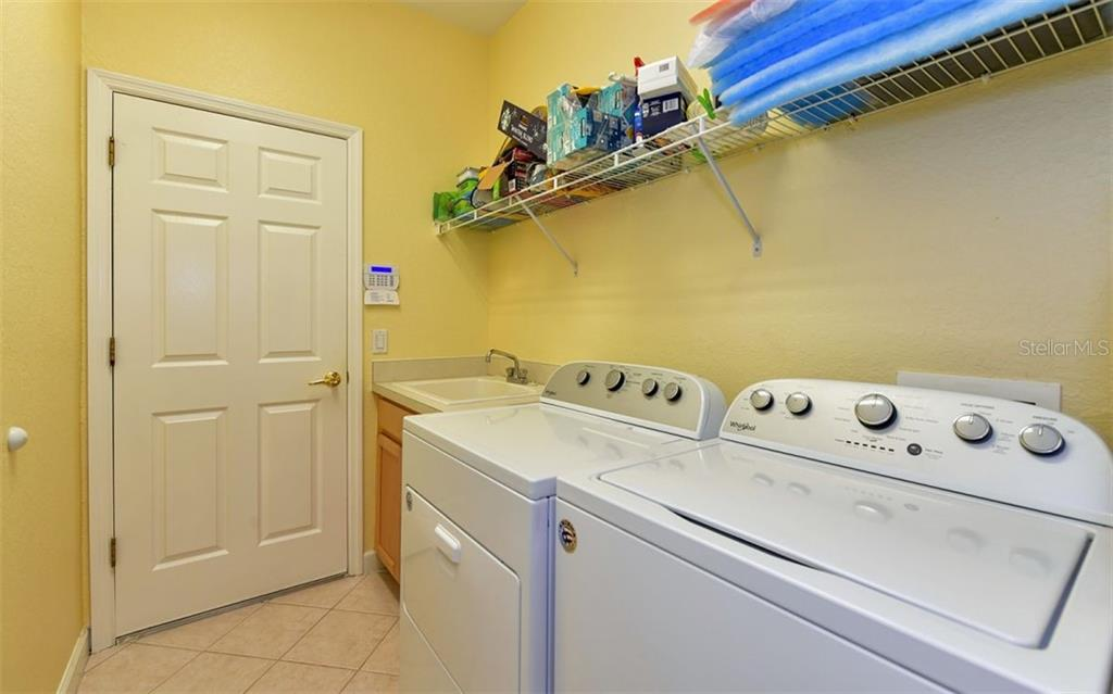 Laundry with utility tub - Villa for sale at 4812 Lakescene Pl, Sarasota, FL 34243 - MLS Number is A4486070