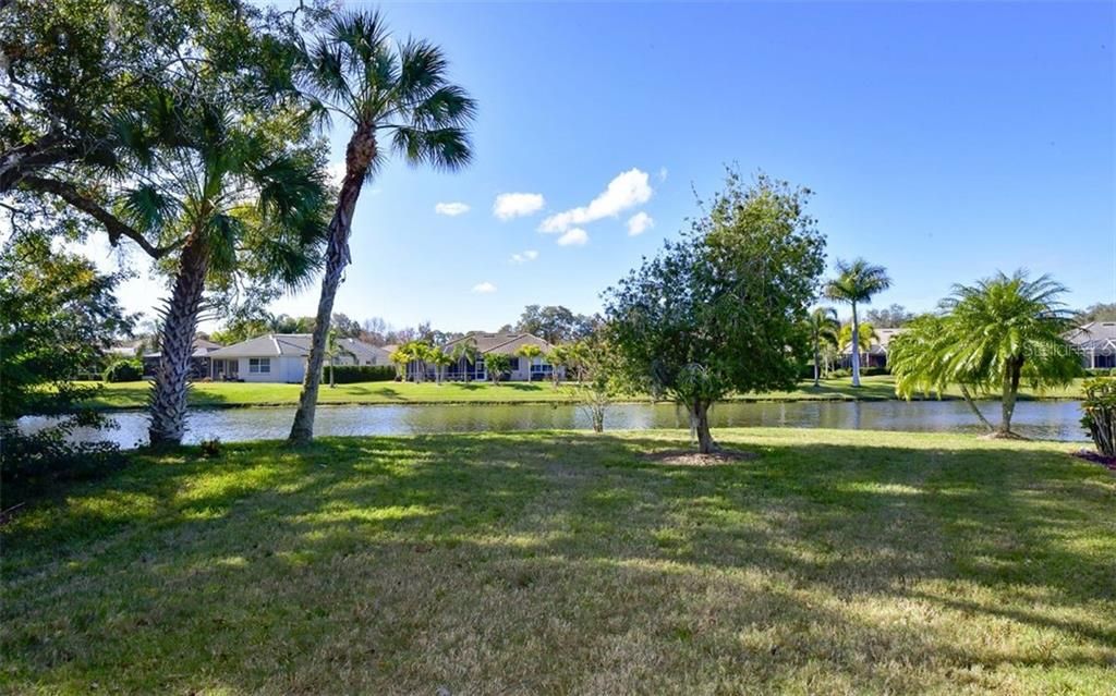 Pond view behind the home. - Villa for sale at 4812 Lakescene Pl, Sarasota, FL 34243 - MLS Number is A4486070