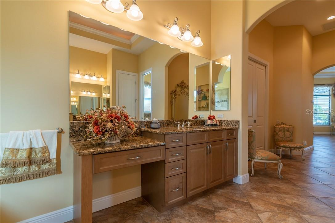 One of the two vanities in the Owners' Suite Bathroom. - Single Family Home for sale at 11720 Rive Isle Run, Parrish, FL 34219 - MLS Number is A4486302