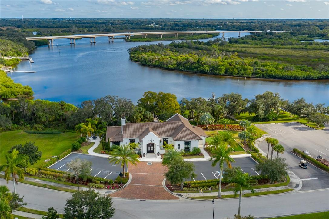 The River Lodge is an amenity exclusively for the use of residents of The Islands on the Manatee River.  It features a private Fitness Center, a beautiful club room served by a bar, a huge lanai with premium appliances on the outdoor kitchen, a fire pit, outdoor ping pong table, a Day Dock, Putting Green and Bocce Ball Court alongside the community Boat Launch, Kayak Launch and Picnic Area. - Single Family Home for sale at 11720 Rive Isle Run, Parrish, FL 34219 - MLS Number is A4486302