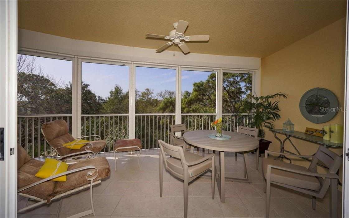 Screened balcony to enjoy a morning cup of coffee - Condo for sale at 409 N Point Rd #402, Osprey, FL 34229 - MLS Number is A4491620