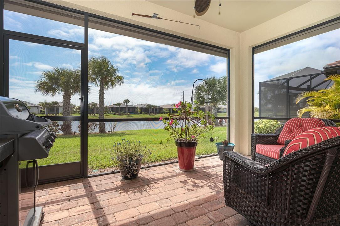 Enjoy your patio in all seasons with the remote control operated shades! Offering privacy, sun protection and hurricane protection. - Villa for sale at 13883 Botteri St, Venice, FL 34293 - MLS Number is A4493523