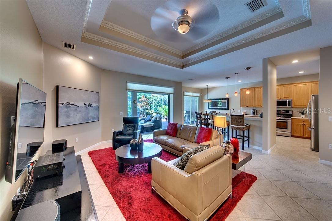 Great Room Opens Seamlessly into Gourmet Kitchen and Lanai - Single Family Home for sale at 7739 Us Open Loop, Lakewood Ranch, FL 34202 - MLS Number is A4494156