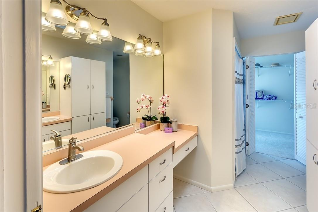 Owners en-suite bath with facing dual countertops and sinks - Single Family Home for sale at 1908 72nd St Nw, Bradenton, FL 34209 - MLS Number is A4495621