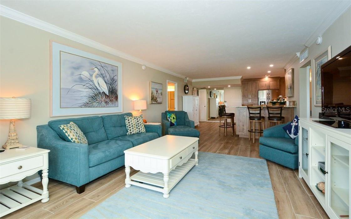 Living Room and Dining Room - Condo for sale at 1200 E Peppertree Ln #602, Sarasota, FL 34242 - MLS Number is A4495963