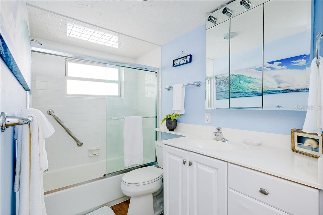 Guest Bathroom with Tub/Shower Combo - Condo for sale at 6300 Midnight Pass Rd #701, Sarasota, FL 34242 - MLS Number is A4496847