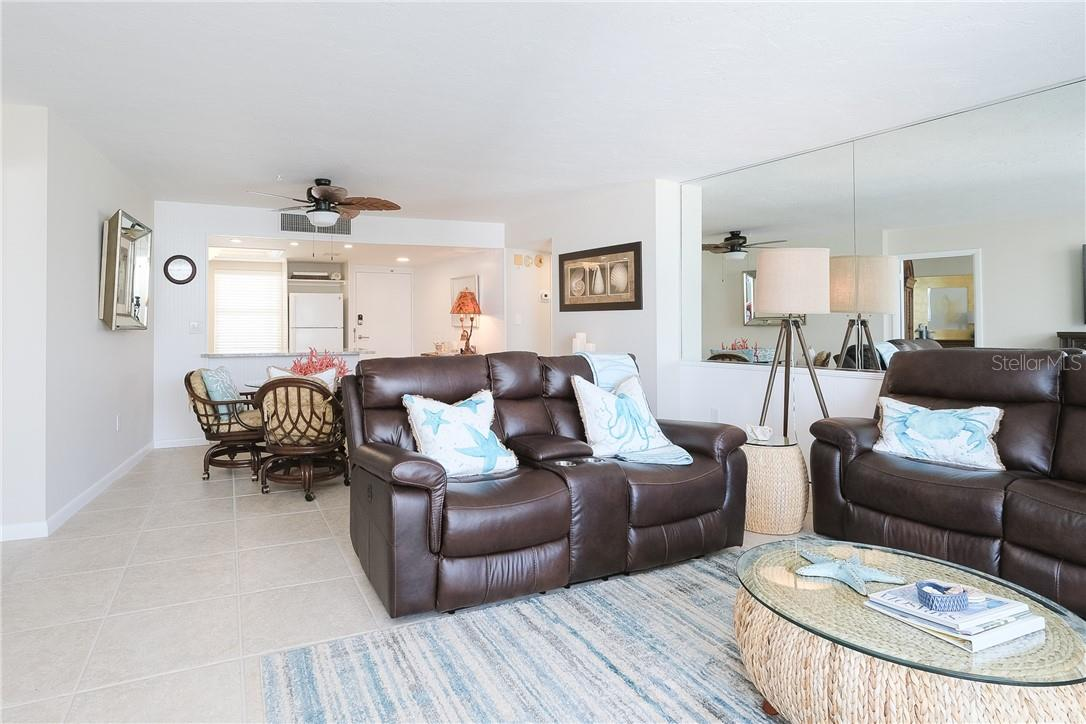 Living Room/Dining Area - Condo for sale at 6300 Midnight Pass Rd #701, Sarasota, FL 34242 - MLS Number is A4496847