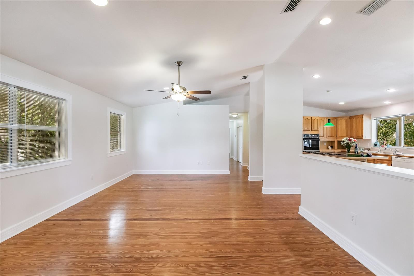 Entering the Front door and looking straight ahead into the Living Room. Lots of well placed windows provide natural light and great breezes! - Single Family Home for sale at 7811 27th Ave W, Bradenton, FL 34209 - MLS Number is A4499385