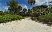 The driveway leads to 175' of private beach. - Vacant Land for sale at 608 N Casey Key Rd, Osprey, FL 34229 - MLS Number is A4127758