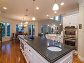 Kitchen island - Single Family Home for sale at 5555 Cape Leyte Dr, Sarasota, FL 34242 - MLS Number is A4157475