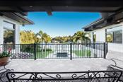 Your balcony view of the pool and canal basin - Single Family Home for sale at 875 Siesta Key Cir, Sarasota, FL 34242 - MLS Number is A4177361
