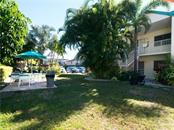 Picnic area behind building C - for use by all - Condo for sale at 100 73rd St #202a, Holmes Beach, FL 34217 - MLS Number is A4184505