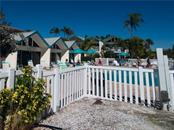 Pool and poolside units - Condo for sale at 100 73rd St #204a, Holmes Beach, FL 34217 - MLS Number is A4185340