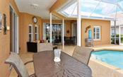 Covered dining and lounging area. - Single Family Home for sale at 4121 Via Mirada, Sarasota, FL 34238 - MLS Number is A4186485