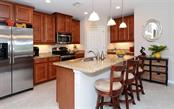 Kitchen with breakfast counter - Condo for sale at 81 Navigation Cir #103, Osprey, FL 34229 - MLS Number is A4188370