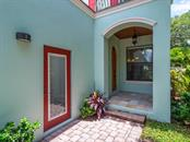 Charming front entrance along with side entrance to garage. - Single Family Home for sale at 1884 Grove St, Sarasota, FL 34239 - MLS Number is A4189365