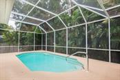 The pool in it's own little paradise.....at the end of the long lanai - Single Family Home for sale at 9122 16th Avenue Cir Nw, Bradenton, FL 34209 - MLS Number is A4189396