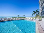 Gulf front swimming pool and sun deck - Condo for sale at 19 Whispering Sands Dr #205, Sarasota, FL 34242 - MLS Number is A4189914