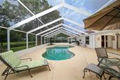 Pool and pool cage installed in 2002 - Single Family Home for sale at 3610 Garden Lakes Clenet, Bradenton, FL 34203 - MLS Number is A4193334