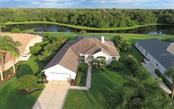The aerial view from the front - gives a real appreciation for the expansive water and privacy offered from the back of this home. - Single Family Home for sale at 3408 Little Country Rd, Parrish, FL 34219 - MLS Number is A4193677