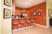 Step-up counter for casual dining - Villa for sale at 2127 Burgos Dr, Sarasota, FL 34238 - MLS Number is A4195921