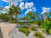 Newly Landscaped Backyard Overlooking the Gulf of Mexico - Single Family Home for sale at 418 N Casey Key Rd, Osprey, FL 34229 - MLS Number is A4198549