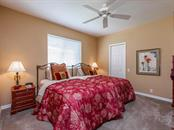 Guest suite with walk-in closet and bath access. - Single Family Home for sale at 4887 Carrington Cir, Sarasota, FL 34243 - MLS Number is A4199511