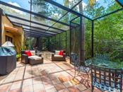 View of screened outdoor room - Single Family Home for sale at 7340 Pine Needle Rd, Sarasota, FL 34242 - MLS Number is A4200855