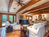 Living room with French doors and vaulted ceiling - Single Family Home for sale at 7340 Pine Needle Rd, Sarasota, FL 34242 - MLS Number is A4200855