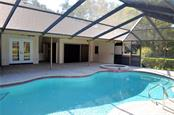 lots of covered lanai, allows a perfect spot for viewing the sunsets. full pool bath (just behind the spa) - Single Family Home for sale at 7529 Weeping Willow Blvd, Sarasota, FL 34241 - MLS Number is A4201676
