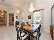 Formal dining/vaulted celings - Single Family Home for sale at 709 Sawgrass Bridge Rd, Venice, FL 34292 - MLS Number is A4201753