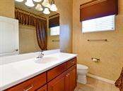 Guest bathroom complete with warm finishes - Single Family Home for sale at 12071 Aster Ave, Bradenton, FL 34212 - MLS Number is A4205214