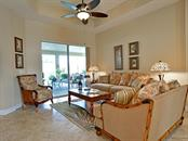 Outdoor living access from living room - Single Family Home for sale at 6601 Horned Owl Pl, Sarasota, FL 34241 - MLS Number is A4205612